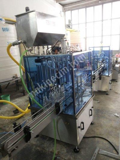 Satılık Sıfır 4lü Sıvı Sabun Dolum Makinası Fiyatları İstanbul likit dolum,otomatik,ambalaj,filling,full automatic,rotatif dolum,zeyin yağı,dolum,sıvı dolum,çamaşır suyu dolum makinası,sıvı sabun dolum makinası