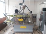 Horizontal powder filling and packaging machine